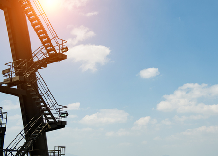 Close up of large shipping crane featuring stairs.