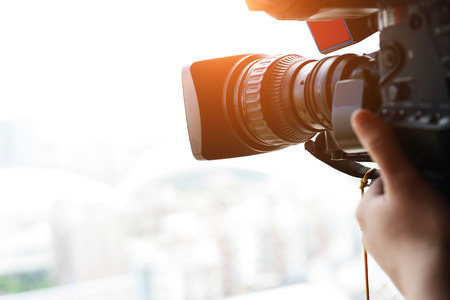 zoom: close up of television operator with camera. Stock Photo