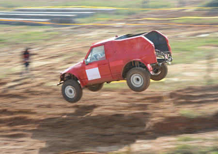 Driver competing in an off-road 4x4 competition.