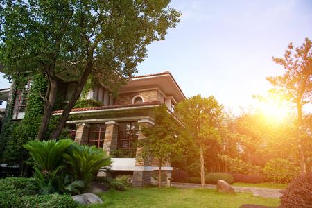 Brick suburban home on a sunny summer day.