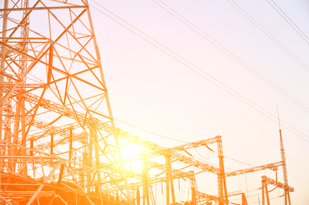 powe: Electric power station against bright sky. Stock Photo