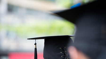 completion: back of graduates during commencement. Stock Photo