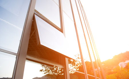 windows opend from modern glass office building. Editorial