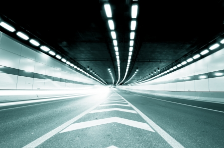 Abstract speed motion in urban highway road tunnel, blurred motion toward the central  Shot from a slow moving car  photo