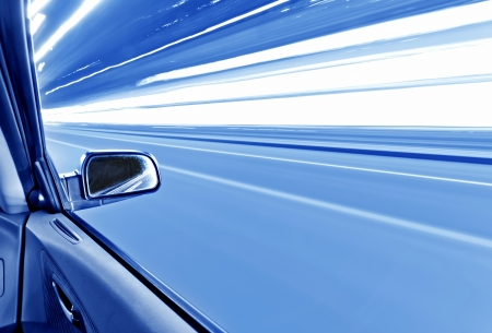 car on the road wiht motion blur background Stock Photo - 16025663