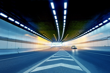 toward: Abstract speed motion in urban highway road tunnel, blurred motion toward the central  Shot from a slow moving car