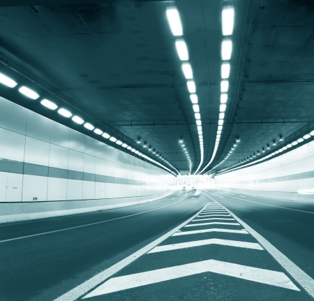 Abstract speed motion in urban highway road tunnel, blurred motion toward the central  Shot from a slow moving car  Stock Photo - 16026720