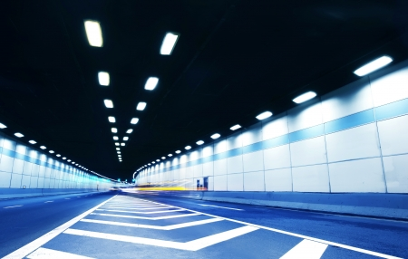 Abstract speed motion in urban highway road tunnel, blurred motion toward the central  Shot from a slow moving car Stock Photo - 16026800