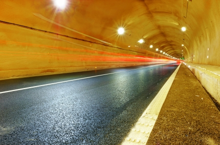 Abstract speed motion in urban highway road tunnel, blurred motion toward the central  Shot from a slow moving car Stock Photo - 18617769