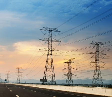 electric grid: high voltage post High-voltage tower sky background Stock Photo