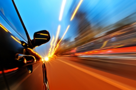 speed car: car on the road with motion blur background.  Stock Photo