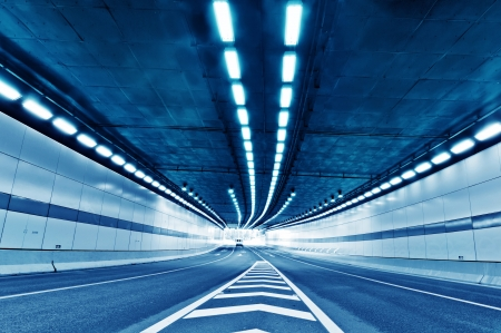 Abstract speed motion in urban highway road tunnel, blurred motion toward the central  Shot from a slow moving car Stock Photo - 18564171