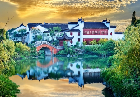 Dusk, pavilions on a river, Chinese architecture   photo