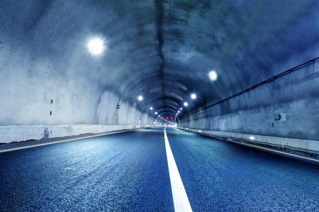 Abstract speed motion in urban highway road tunnel, blurred motion toward the central  Shot from a slow moving car Stock Photo - 18540328