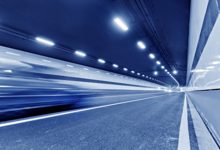 blur subway: Abstract speed motion in urban highway road tunnel, blurred motion toward the central  Shot from a slow moving car Stock Photo