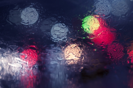 Wet the window with the background of the night city Stock Photo - 18530404