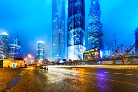 the light trails on the modern building background in shanghai china photo