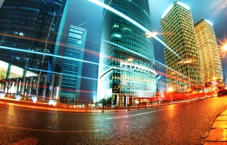 commercial district: the light trails on the modern building background in shanghai china