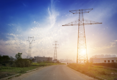 pylon: high voltage post.High-voltage tower sky background,besides the road. Stock Photo