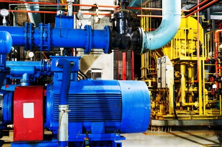 gas pump: Modern boiler room equipment for heating system. Pipelines, water pump, valves, manometers. Stock Photo