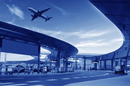 airplane landing: the scene of airport building in shanghai china