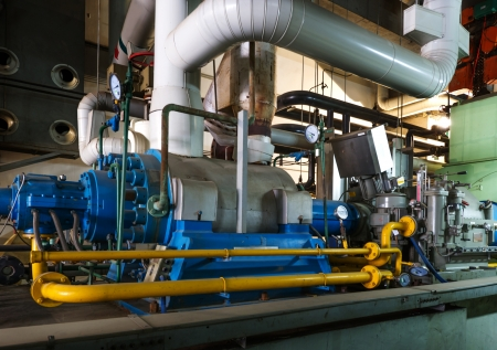 burner: Modern boiler room equipment for heating system. Pipelines, water pump, valves, manometers. Stock Photo