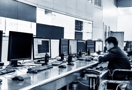 Modern plant control room and computer monitors Stock Photo