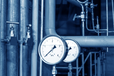 heat pump: Closeup of manometer, pipes and faucet valves of heating system in a boiler room
