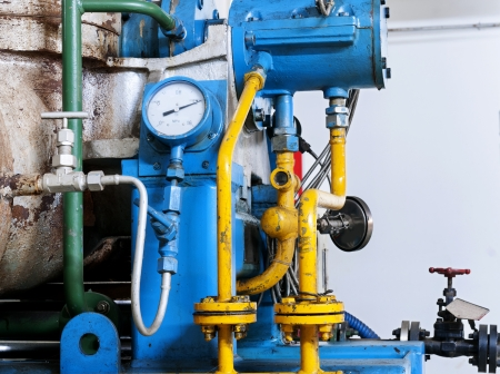 gas gauge: Closeup of manometer, pipes and faucet valves of heating system in a boiler room