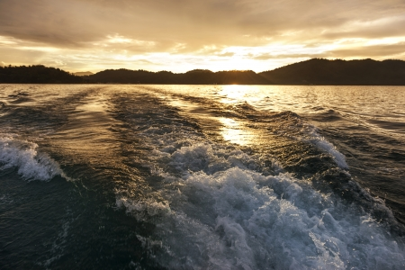 churning: Churning water in the ocean shows lots of turbulence and splash sunset, Good for background image