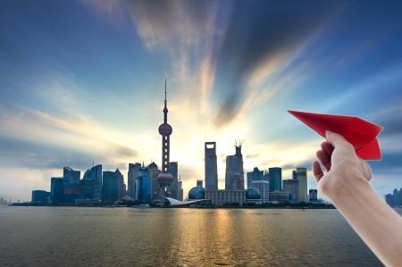 impressive: Beautiful Shanghai Pudong skyline,Paper Airplane Fly Stock Photo