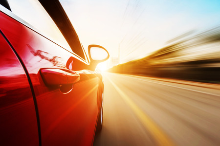 fast cars: A car driving on a motorway at high speeds, overtaking other cars Stock Photo