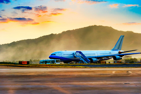 Airplane near the terminal in an airport at the sunset 版權商用圖片