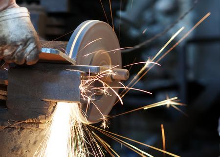 welding machine: metal sawing close up