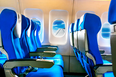 Empty aircraft seats and windows. photo
