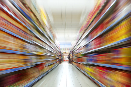 convenience store: Wide perspective of empty supermarket aisle Stock Photo