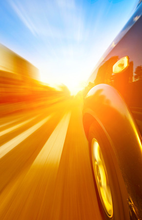 A car driving on a motorway at high speeds, overtaking other cars photo