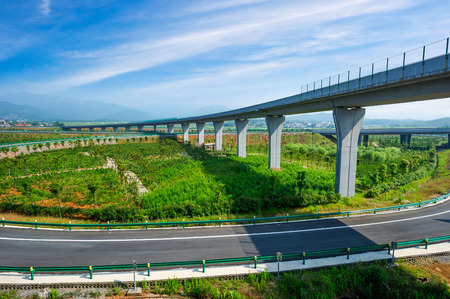 tilted view: Highway and viaduct under the blue sky Stock Photo