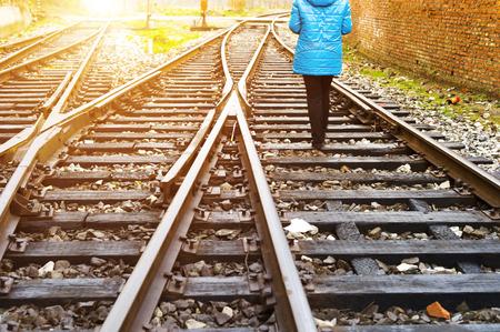 railway points: The way forward railway,beautiful girl walking on the railway Stock Photo