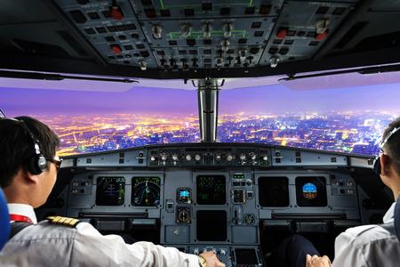 plane cockpit and city of night photo