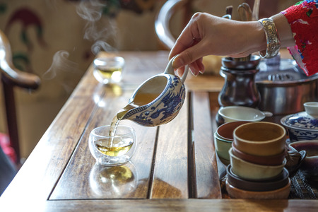 women holding cup: Chinese tea ceremony Stock Photo