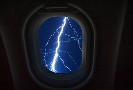 going places: Looking out the window of a plane,lighting