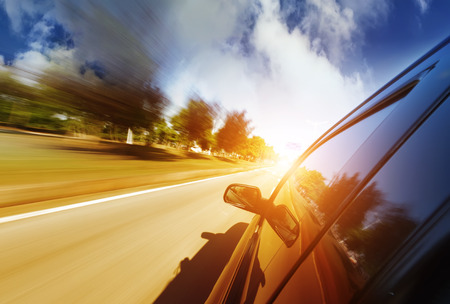 overtaking: A car driving on a motorway at high speeds, overtaking other cars Stock Photo