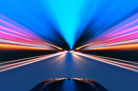 speed line: A car driving on a motorway at high speeds, overtaking other cars Stock Photo