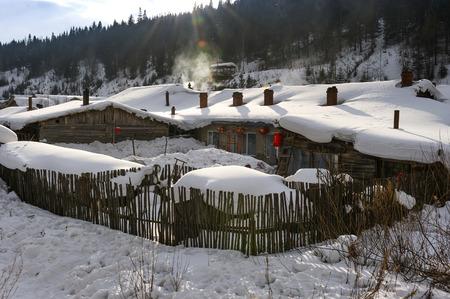 Chinese characteristic farmhouse snowscape photo