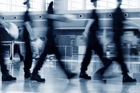 airport security: A group of airport security Crew Walking in the Airport