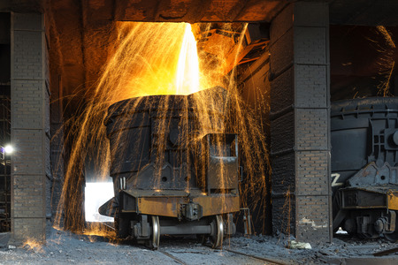 smelting plant: Smelting metal in a metallurgical plant. Liquid iron from the ladle
