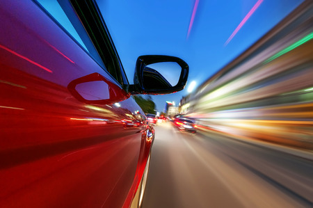 high street: car on the road with motion blur background Stock Photo