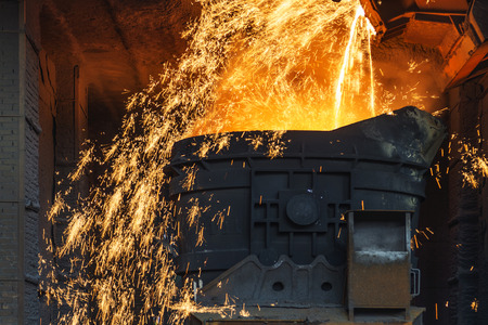 foundry: Smelting metal in a metallurgical plant. Liquid iron from the ladle