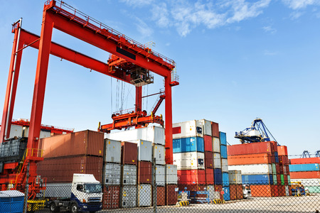 intermodal: Pier under the blue sky, cranes and containers. Stock Photo